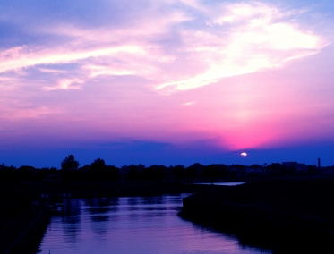 NO permissions granted for thisblue sunset over water. ALL rights reserved. Copyrighted.