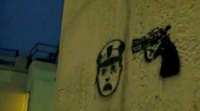 Stenciled cop with gun to his head anti-law enforcement graffiti.(Screenshot ch2 news)