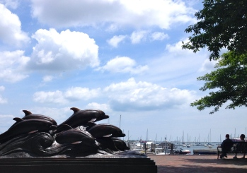 (ALL rights reserved for this image)Dolphins sculpture in Boston Harbor (NO permissions granted. Copy righted).