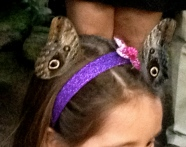 Owl butterflies (NO permissions granted) on little girl's head. ALL rights reserved. Copy righted