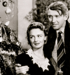 Couple in front of a Christmas tree. (It's a Wonderful Life. RKO Radio Pictures/USPD: pub,date,exp.cr/Commons.wikimedia.org)