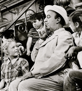 Children around man in suit1959. Ed Wynn in Twilight Zone.One For the Angels episode/CBS publicity material by Bureau of Industrial Service/USPD: pub.date, no cr/Commons.wikimedia.org)