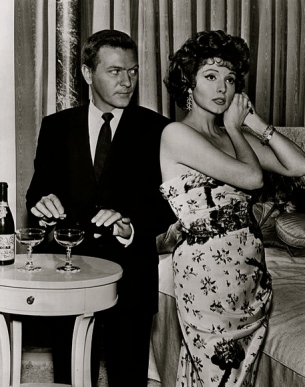Vintage couple having cocktails. 1960.Twilight Zone. The Chaser episode/CBS.Bureau of Industrial Service/USPD:pub.date, pub.material/Commons.wikimedia.org