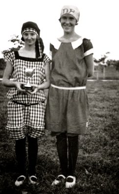 teenage girls dressed in bloomers or sport clothes.1920-1930/Oxley Library.Queensland. Released PD/Commons.wikimedia.org)