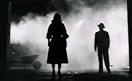 man and woman in shadows and fog.1955.movie trailer The Big Combo/Allied Artists/US PD: pub.date, no cr notice/Commons.wikimedia.org)