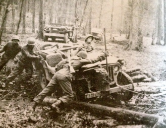 Soldiers forcing jeep through mud/Rianbow Div.Vet. Memorial Foundation, inc. 1979