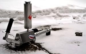 Shark design on flamethrower in snowbank (image: enadget.com)