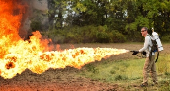 Man using X15 flamethrower in a field. (Throwflame.com)