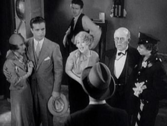 crowd of people with woman talking. (1933. Gold Diggers trailer by Warner Bros./USPD.pub.date/Commons.wikimedia.org)