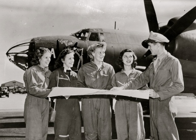 1942-45 Four women pilots,.WASP, getting final instructions before cross country flight. B-26 Maurauder medium bomber planes ferried as well as towing targets for practice. (NARA/USPD by fed. employee/Commons.wikimedia.org)