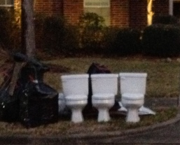 three potties on the curb with the garbage. ALL rights reserved. Copyrighted