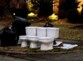 3 ceramic potties on the curb on garbage day. NO permissions granted. All rights reserved. Copyrighted