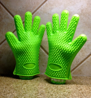 Pair of green kitchen gloves deeply absorbed in conversation. ALL rights reserved. Copyrighted. NO permissions granted