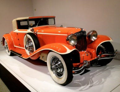 Car. side view of orange Art Deco exhibit vehicle . ALL rights reserved. Copyrighted. NO permissions granted