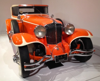 Grill and front view of orange Art Deco exhibit vehicle. ALL rights reserved. Copyrighted. No permissions granted.