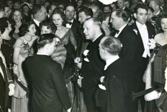 Crowd of elegant people waiting to get into the Shamrocks's grand opening parties. March 17, 1949. (Houston Chronicle)