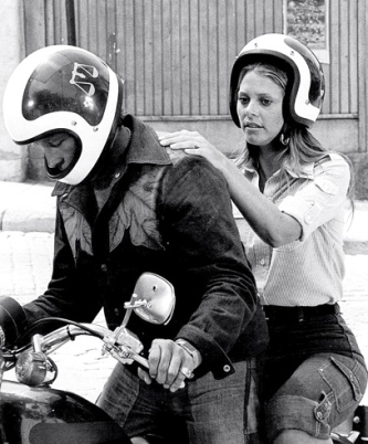 Couple on motorcycle.1977 Bionic Woman.(Lindsay Wagner and Evel Knievel) NBC.(USPD.pub.date/Commons.wikimedia.org