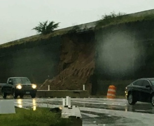 collapsed freeway retaining wall. (Jennifer O'Rourke)