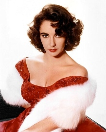 Elizabeth Taylor in red dress and fur., 1955? (Studio publicity still/USPD.pub.date, cr lapsed/Commons.wikimedia.org)