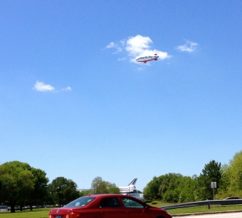 Space shuttle transport being visited by blimp. NO permissions granted. Copyrighted. ALL rights reserved