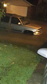 SUV in street flood. abc13.com