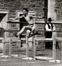 Man jumping hurdles. 1904 Summer Olympics. Harry Hillman. (USPD.pub.date/Common.wikimedia.org)