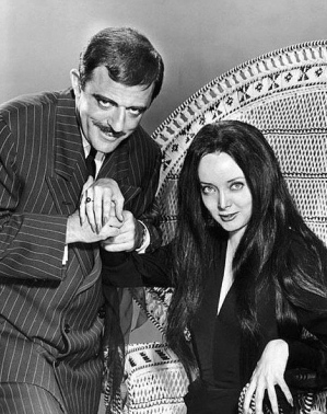 man and woman. Addams Family. 1964.Morticia/Carolyn Jones. Gomex:/john Astin (ABC/USPD.pub.date,no cr/Commons.wikimedia.org)