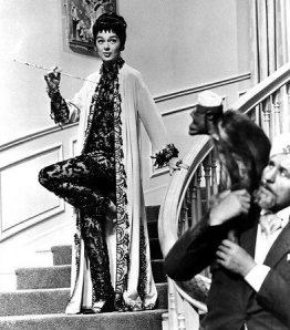 Eccentric woman on stairs. Auntie Mame. Rosalind Russell (Rotten Tomatoes/dharmabumdri)