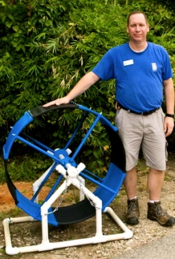 Exercise wheel for Lilly the Skunk. What makes her world go round.(M. Griffith.Houston Zoo)