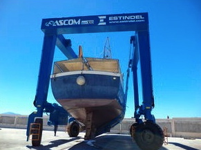 MacBoat in big marine travel lift. Remotely controlled travel lift with all wheel steering. Capacity up to 130 tons (nauticexpo.com)
