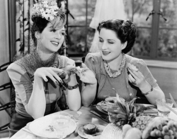 "Two women at lunch. . Rosalind Russell in the movie ""The Women"" (USPD. pub date, publicity still/Commons.wikimedia.org))"