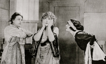 "three women.1922. lobby card ""Any Wife""/USPD.pub.date/Commons.wikimedia.org)"
