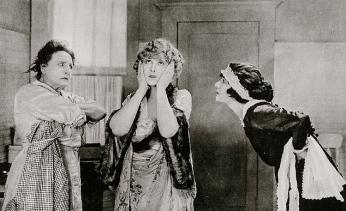 "three women.1922. lobby card ""Any Wife""/USPD.pub.date/Commons.wikimedia.org)"