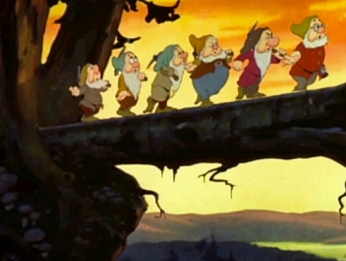 Dwarfs marching over a log bridge. 1937. Snow White and the Seven Dwarfs trailer /RKO Radio Pictures/USPD:not cr, pub.date/Commons.wikimedia.org)