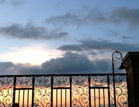 sunset beyond the fence. ALL rights reserved. Copy righted. NO permissions granted