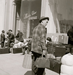 Street scene with young man and suitcases. 1944.Dept of Interior by Dorothea Lange/NARA 1372774 (USPD.by fed employee/Commons.wikimedia.org)