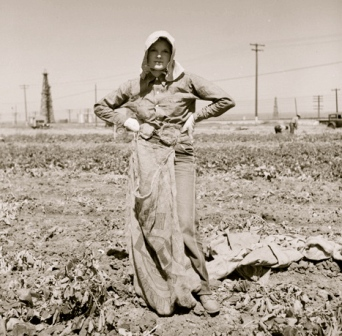 farm girl standing in dusty field. 1940. (USPD. NARA image by Rondal, pub.date.Commons.wikimedia.org)