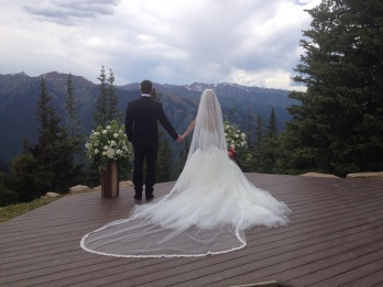 Bride and groom on mountain. ALL rights reserved. Copyrighted. NO permissions granted