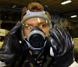 Fireman in gas mask. (USPD: US Navy photo/Commons.wikimedia.org