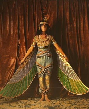 woman in Egyption-look costume with wings. 1915. Geo. Eastman House Collection (USPD.pub.date/Commons.wikimedia.org)