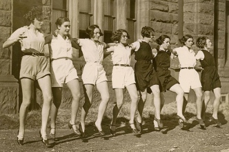 chorus line of girls in vintage dress. 1935. State Lib. of New South Wales/FLickr (USPD.no cr, pub date/Commons.wikimedia.org)