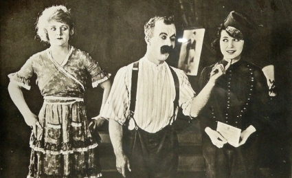 """Man and two women. 1920 lobby card """"Home rule"""". Hart Productions/ (USPD pub.date/ (Commons.wikimedia.org)"""