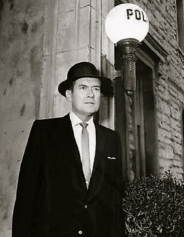"Serious police detective in suit.1957 Frank Lovejoy/ ""Meet Mcgraw""(NBC/USPD: pub.date, no-cr/Commons.wikimedia.org)"