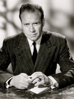 "man in suit at desk. 1957 Lyle Bettger. NBC.""Court of last resort"". (USPD: pub.date.no-cr/Commons.wikimedia.org)"