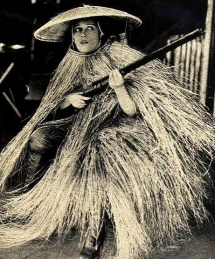 "1919. Gloria Swanson dressed as duck hunting ""walking blind"". Nov edition of Shadowland mag. /USPD. pub.date, artist life/ Commons.wikimedia.org)"