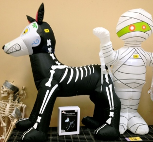 Halloween dog and mummy inflatable yard decorations waiting on shelf to be adopted. (ALL rights reserved. Copyrighted. NO permissions granted)