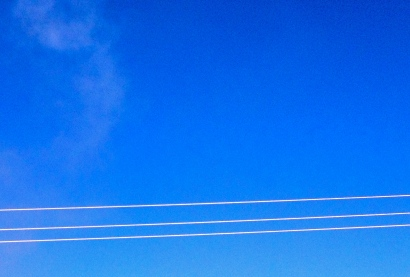 Three silver power lines stretched across a blue sky. ALL rights reserved. NO permissions granted. Copyrighted