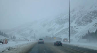 Driving down cold snowy road. ALL rights reserved. NO permissions gratned. Copyrighted