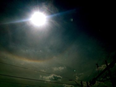 Sun with rainbow rings of red, yellow, and violet. ALL rights reserved. Copyrighted. NO permissions granted