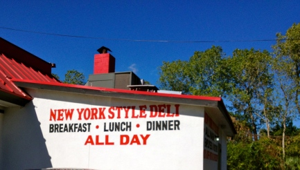 Building with sign for NY style deli. ALL rights reserved. Copyrighted. NO permissions granted